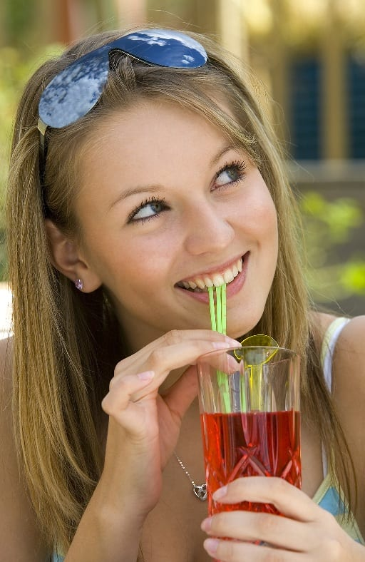 woman with drink and straw
