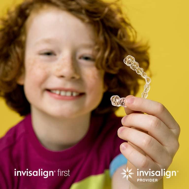 Invisalign-first-kid-holding-invisalign